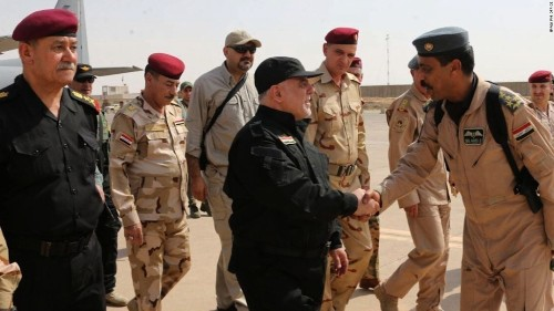 Iraq's PM claims Mosul victory, but state TV says ISIS fighters remain