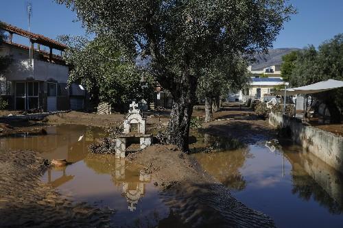 The Latest: Greece floods kill 2; hundreds of homes damaged