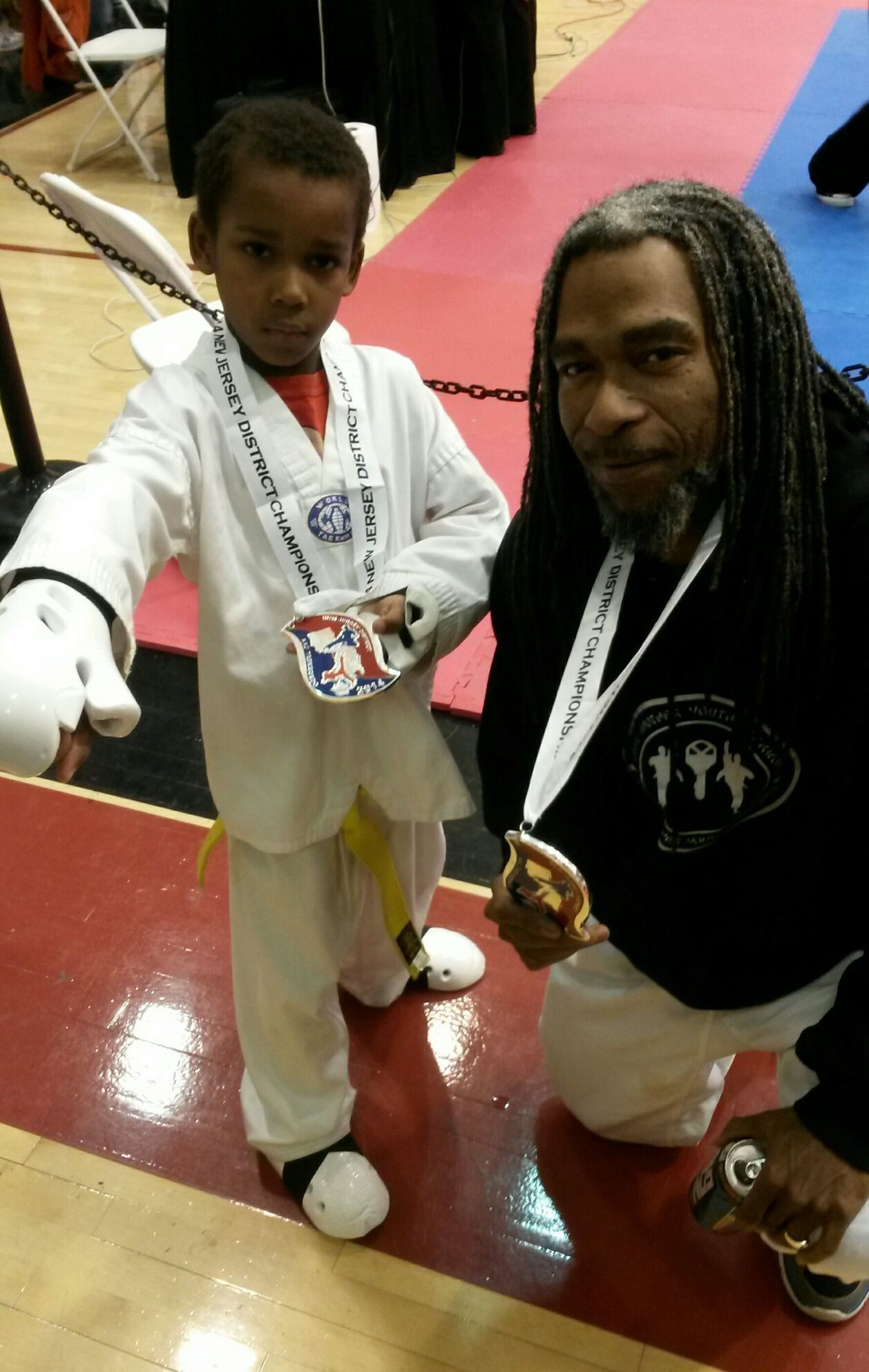 Travis McCloud Jr and Master Tarif Aziz after both winning the silver medal in AAU New Jersey Championship and Qualifier in April of 2014. Both also went on to bring home to Boston it's first AAU Championship.