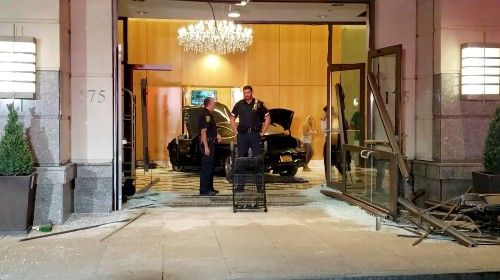 Three people injured when car smashes into Trump Plaza lobby in New York suburb