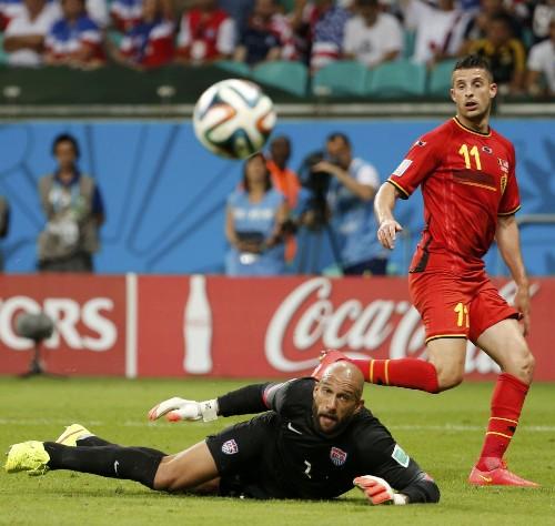 US Loses Late, Argentina Through: Pictures
