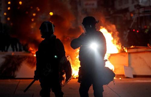 Hong Kong leader to visit Japan after huge rally, night of violence