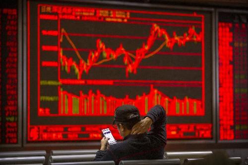 Asian shares mixed amid caution on US-China trade talks