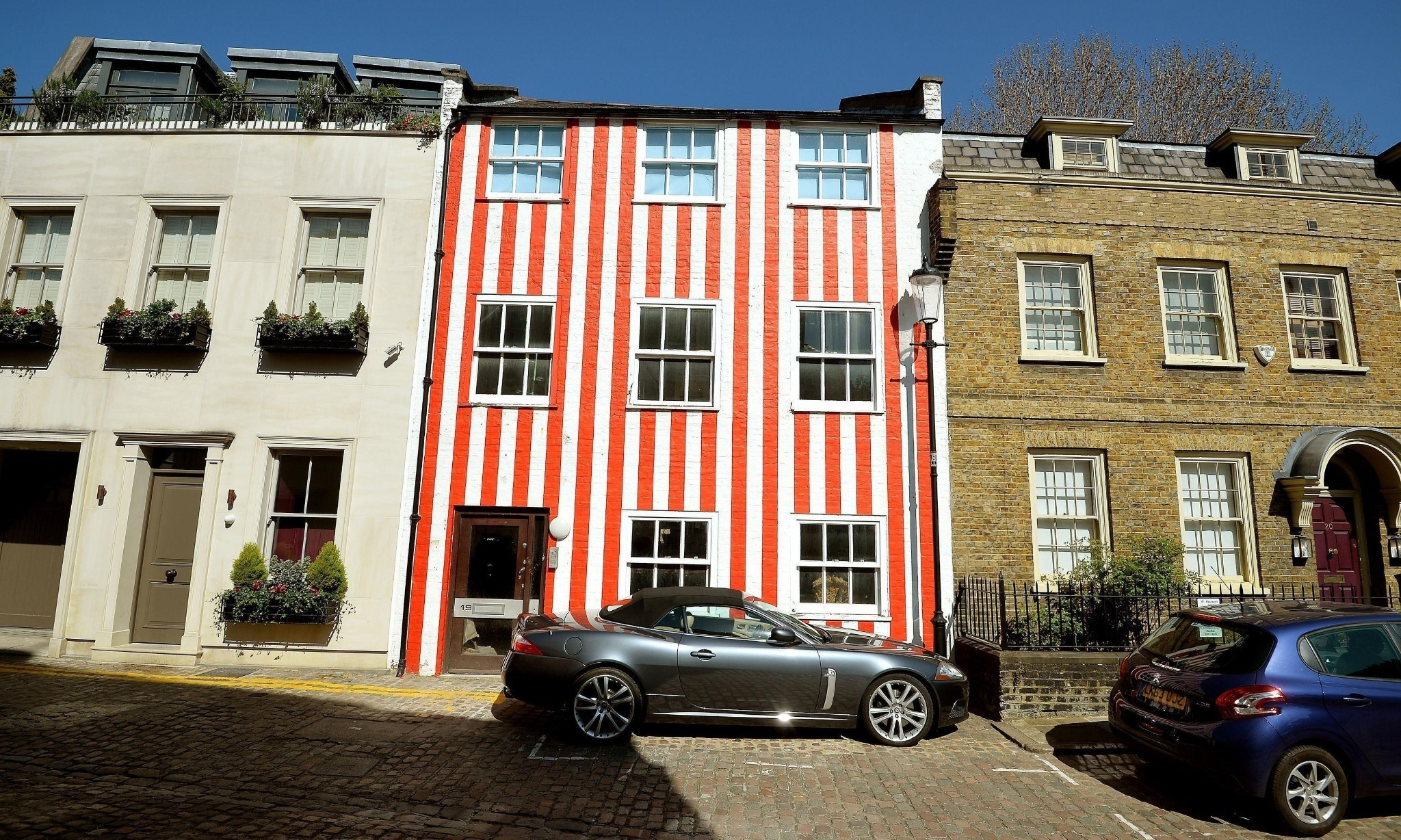 Court rules woman can keep her red and white striped townhouse