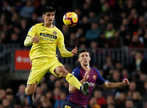 Soccer: Barcelona see off Villarreal to return to top of La Liga