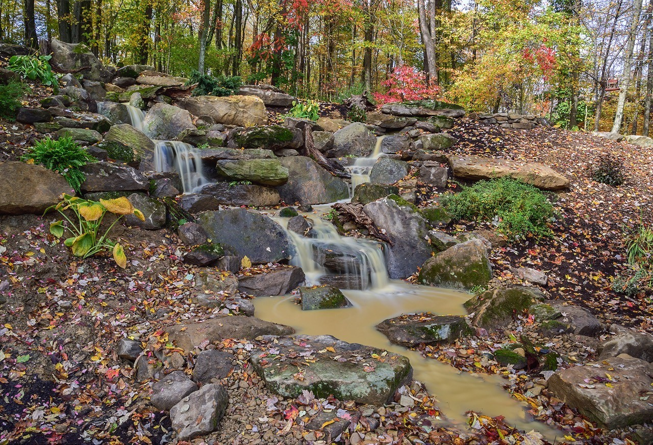 Naturalistic pondless waterfall built in Sarver, PA. (Pic taken just after completion, hence the cloudy water)