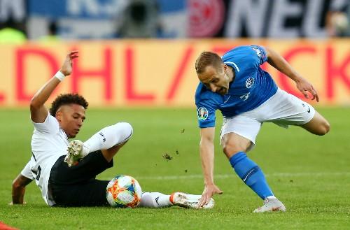 Soccer: Germany crush Estonia 8-0, Northern Ireland earn late win