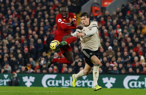 Liverpool go 16 points clear with 2-0 win over Man United