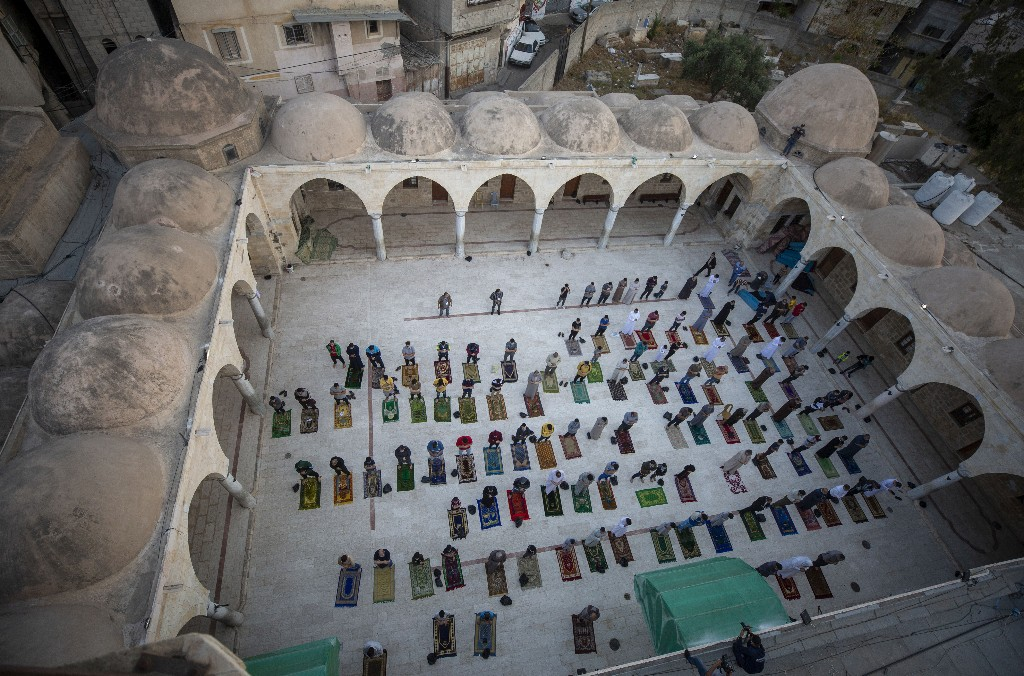 Muslims celebrate major holiday amid curfews, virus fears