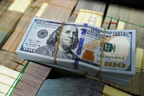 Australian dollar gains after election surprise, yen slips