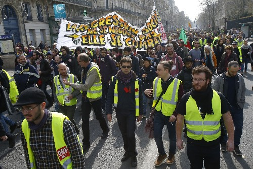 The Latest: Minister: 40K yellow vest protesters nationwide
