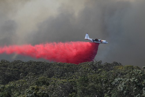 Bushfires rage across Australia's east and west as danger rises