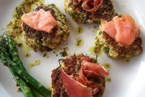 Cauliflower fritters with smoked salmon, prosciutto herbeddressing.