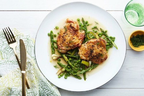 BRAISED CHICKEN WITH ASPARAGUS, PEAS, AND MELTEDLEEKS