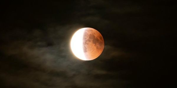 Exactly When And Where To See And Stream Tonight's 'Half-Blood Moon Eclipse' On 'Apollo 11 Day'
