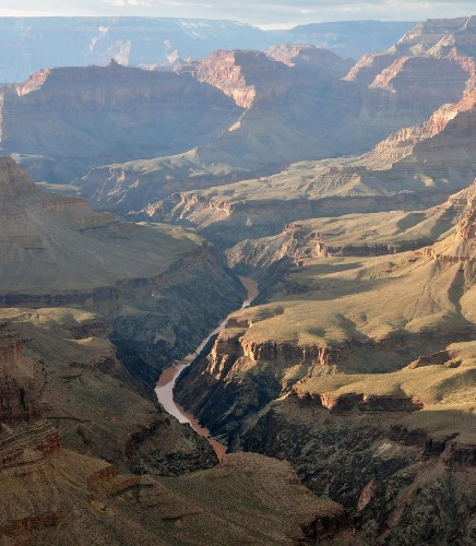 Little Worlds Have Bigger Features: Why Everest And The Grand Canyon Are So Small