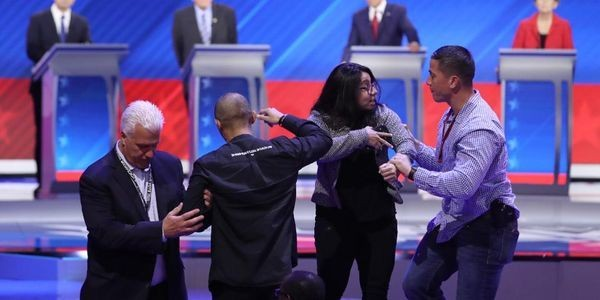 Protesters Interrupted Last Night's Democratic Debate. Here's What They Were Saying.