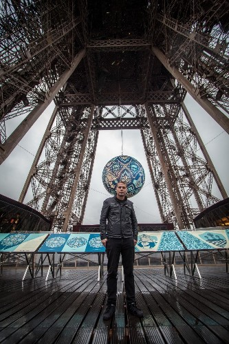 Street Artist Shepard Fairey Talks About His Artwork for the Eiffel Tower During COP21 in Paris