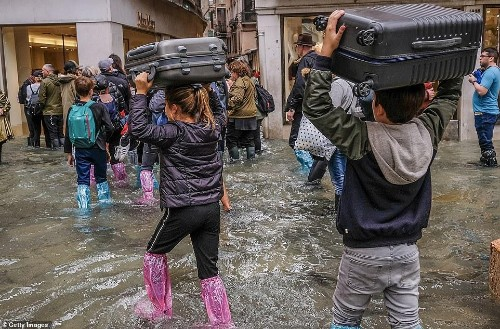 Venice Under Water While Flooded With Stranded Tourists