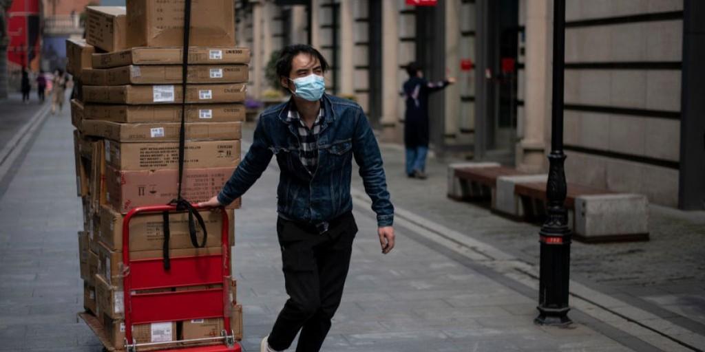 Chinese struggle to return to work as coronavirus controls ease