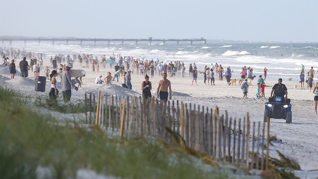 Crowds flock to Florida beaches after governor OKs some to reopen