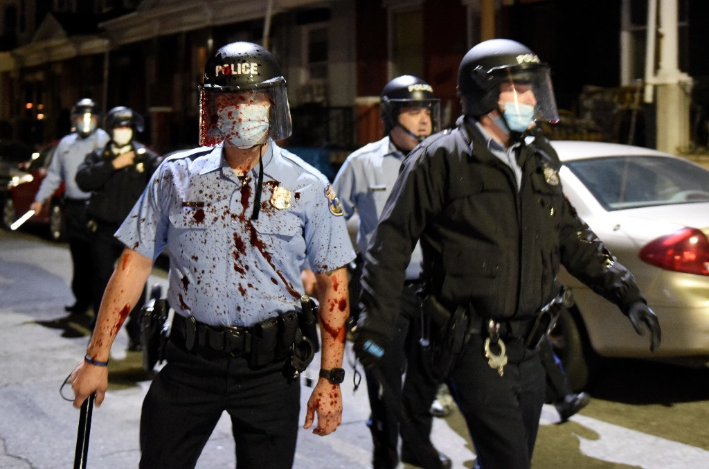 Philadelphia reels from second night of unrest, nearly a dozen shot as victim's family pleads for peace