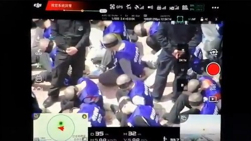 Hundreds of shackled, blindfolded prisoners in China purportedly seen in online videos: report