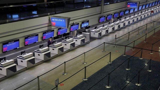 Coronavirus pushes Delta to scale back flights