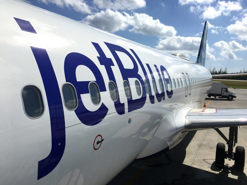 JetBlue passenger wearing Burger King crown hurls racial slurs, assaults flight attendant on plane