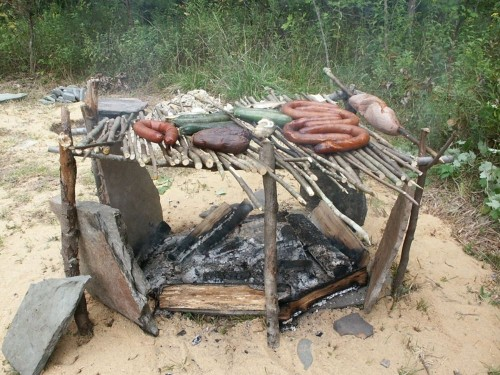 How to build a grill from sticks for campsite cooking