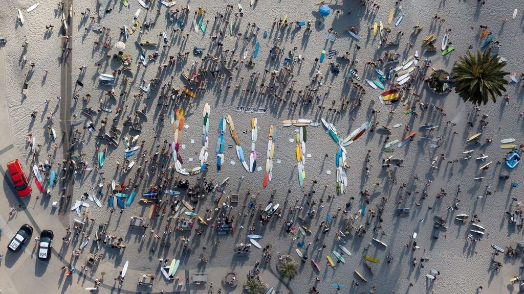 California surfers spell out 'unity' with boards before staging paddle out in George Floyd's memory