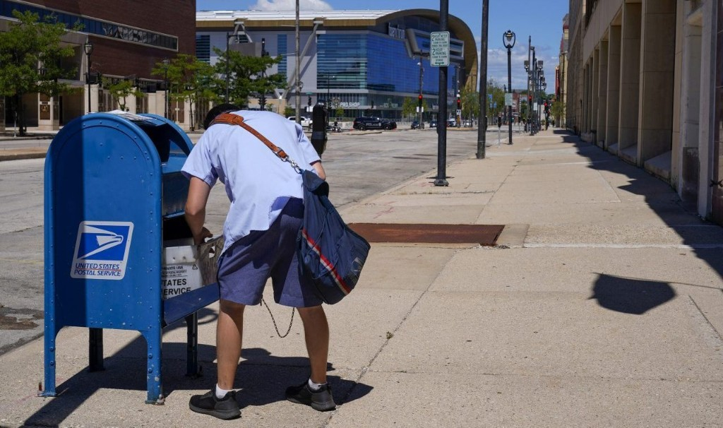 Federal judge orders USPS to lift limits on extra trips to increase election mail deliveries