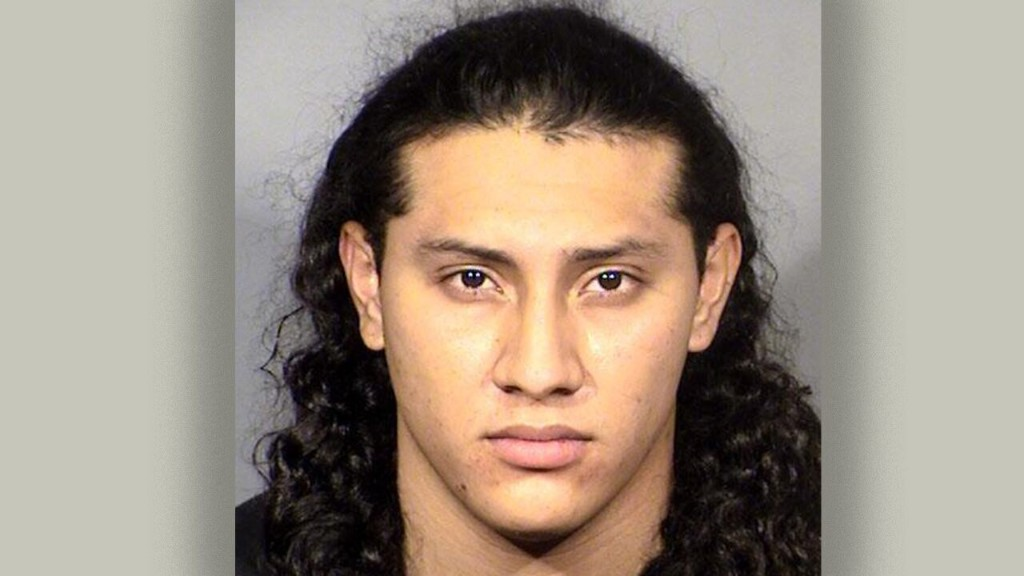 Las Vegas cops make arrest after bicyclist killed by man hanging out of minivan