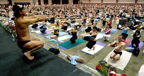 Bikram yoga guru faces arrest warrant