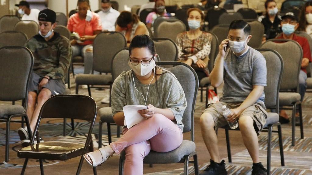 Jobless claims rose last week as coronavirus surge threatens to undermine recovery