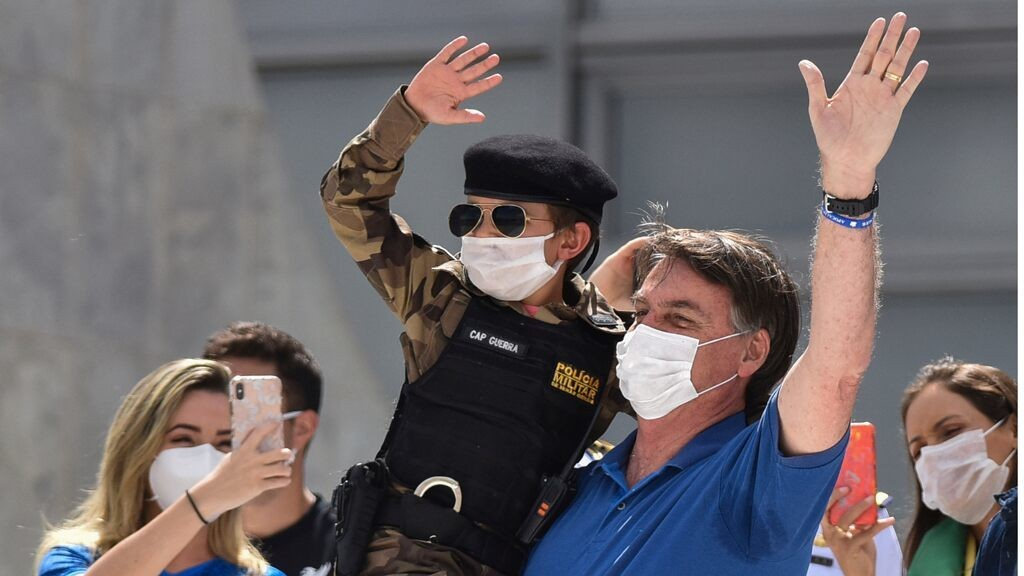 Brazil's Bolsonaro flouts social distancing, poses for pics with kids as São Paulo health system reaches near collapse
