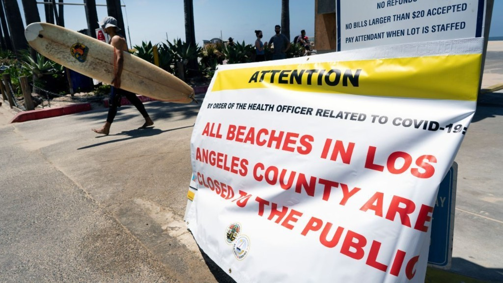 Governor warns California officials to enforce health rules