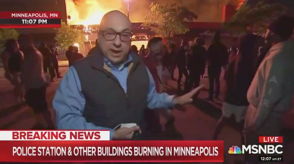 MSNBC's Ali Velshi says situation not 'generally speaking unruly' while standing outside burning building