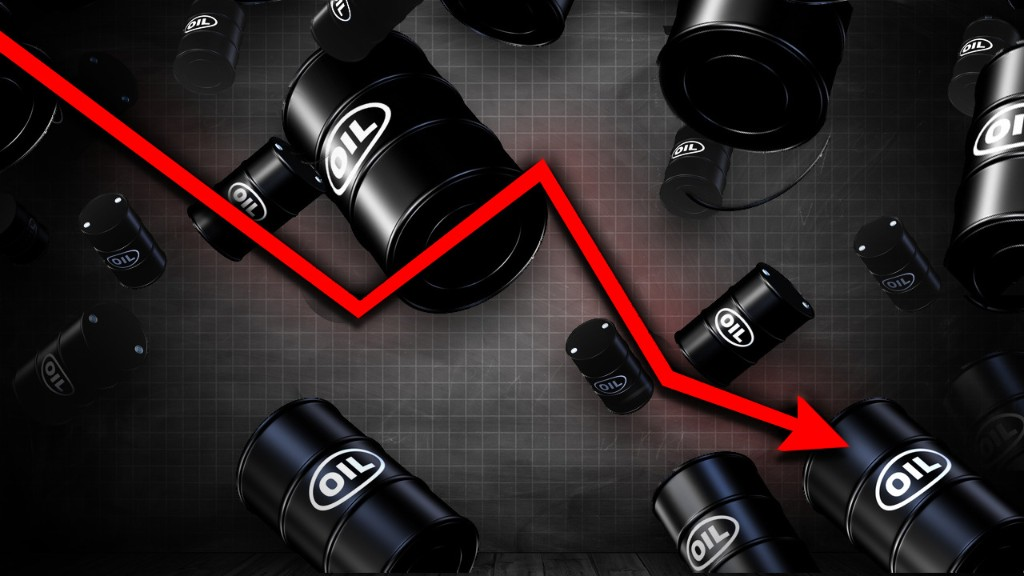 Oil sinks to 18-year low but holds $20 level