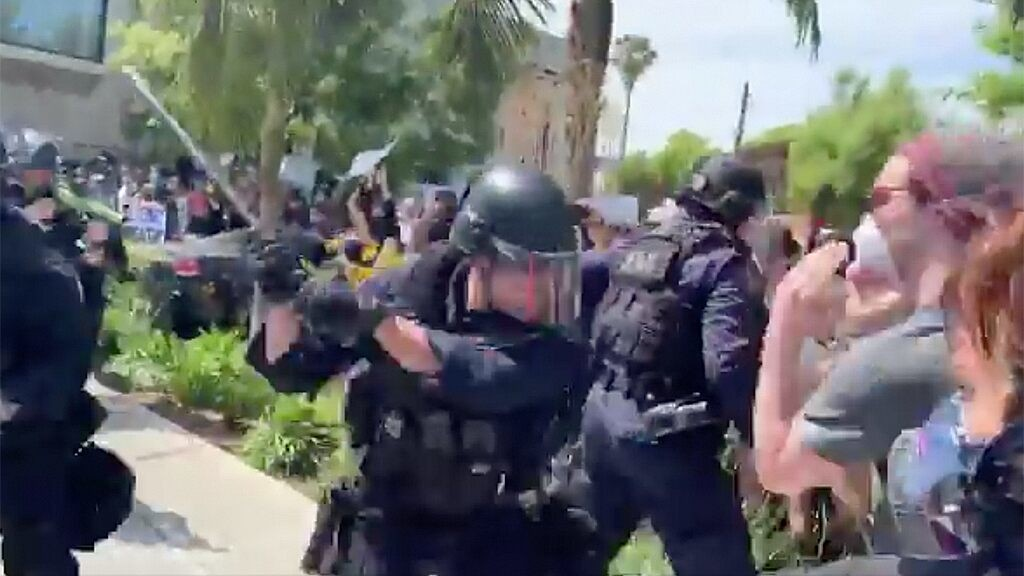 Video shot by actor shows LAPD officers seen striking protesters with batons