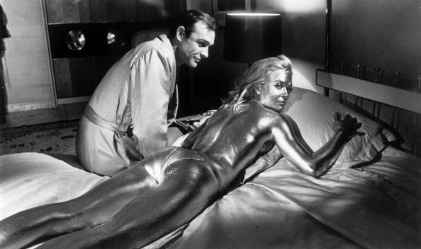 Sean Connery sitting beside co-star, Shirley Eaton