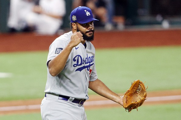 Kenley Jansen of the Los Angeles Dodgers celebrates after closing out...