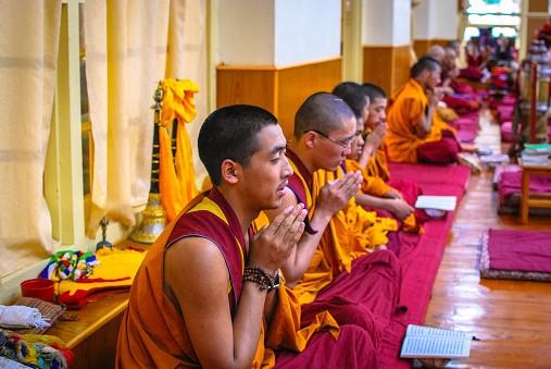 Tibetan Buddhist monks offering morning prayer at the Dalai Lama...