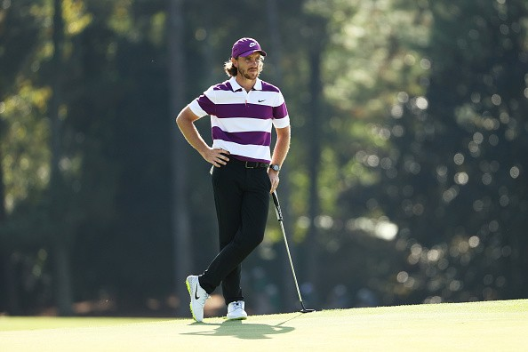 Tommy Fleetwood of England stands on the 18th green during the final...