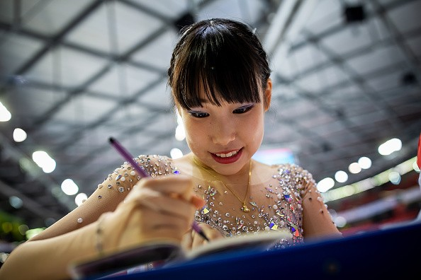 Mai Mihara of Japan signs autographs after the Ladies medal ceremony...