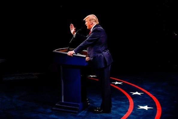 US President Donald Trump speaks during the final presidential debate...