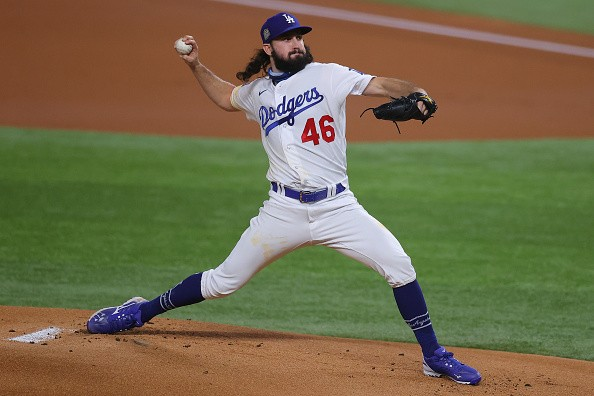 Tony Gonsolin of the Los Angeles Dodgers delivers the pitch against...