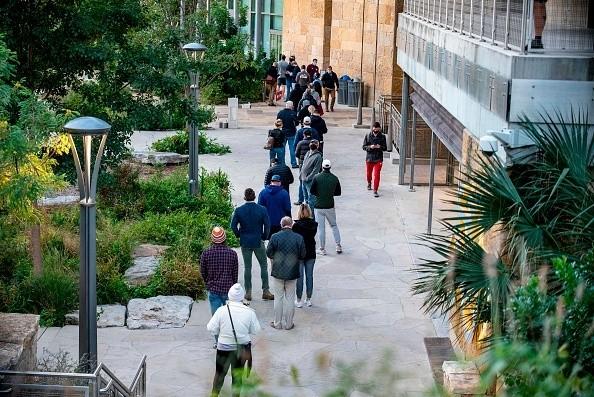 In Austin, Texas, voters wait in line cast their vote