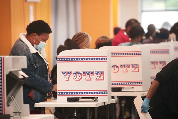 Residents vote at a polling place in the Midtown neighborhood on...