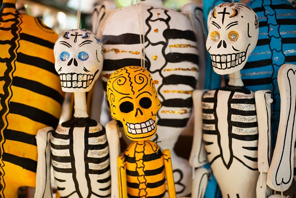 Colorful artisan skeletons, a popular Mexican art created through a...